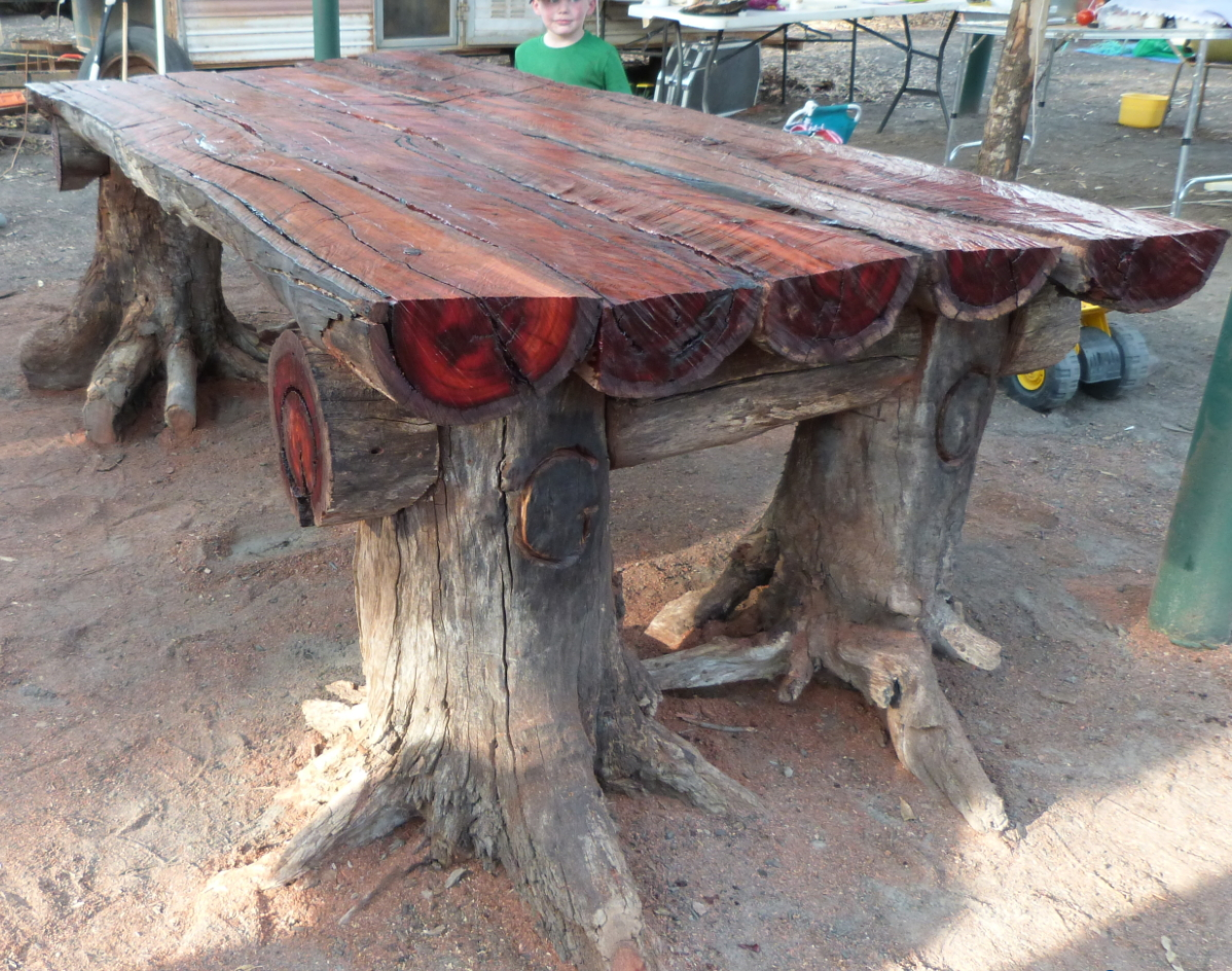 Using a chainsaw i make a very rustic log furniture table with tree stumps for the legs and ripping the logs with the chainsaw for the table top